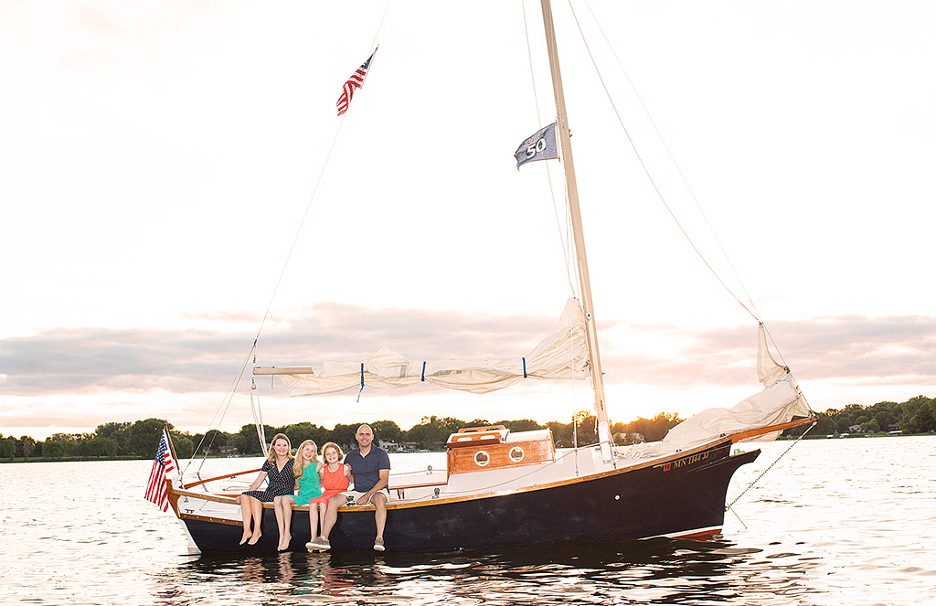 portrait of family on sailboat by pixelations photography